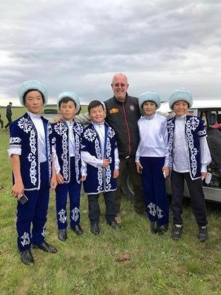 Paul-with-lovely-children-in-traditional-costume-in-Baldashino-Kazhakstan