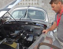 Bas giving Silvia a final mechanical check prior to the start in Beijing